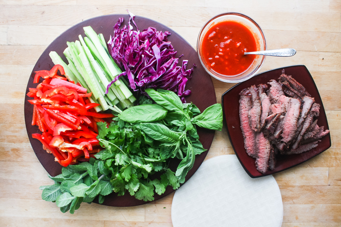 Arrange all of the vegetables and meat on a plate to make assembly easier.