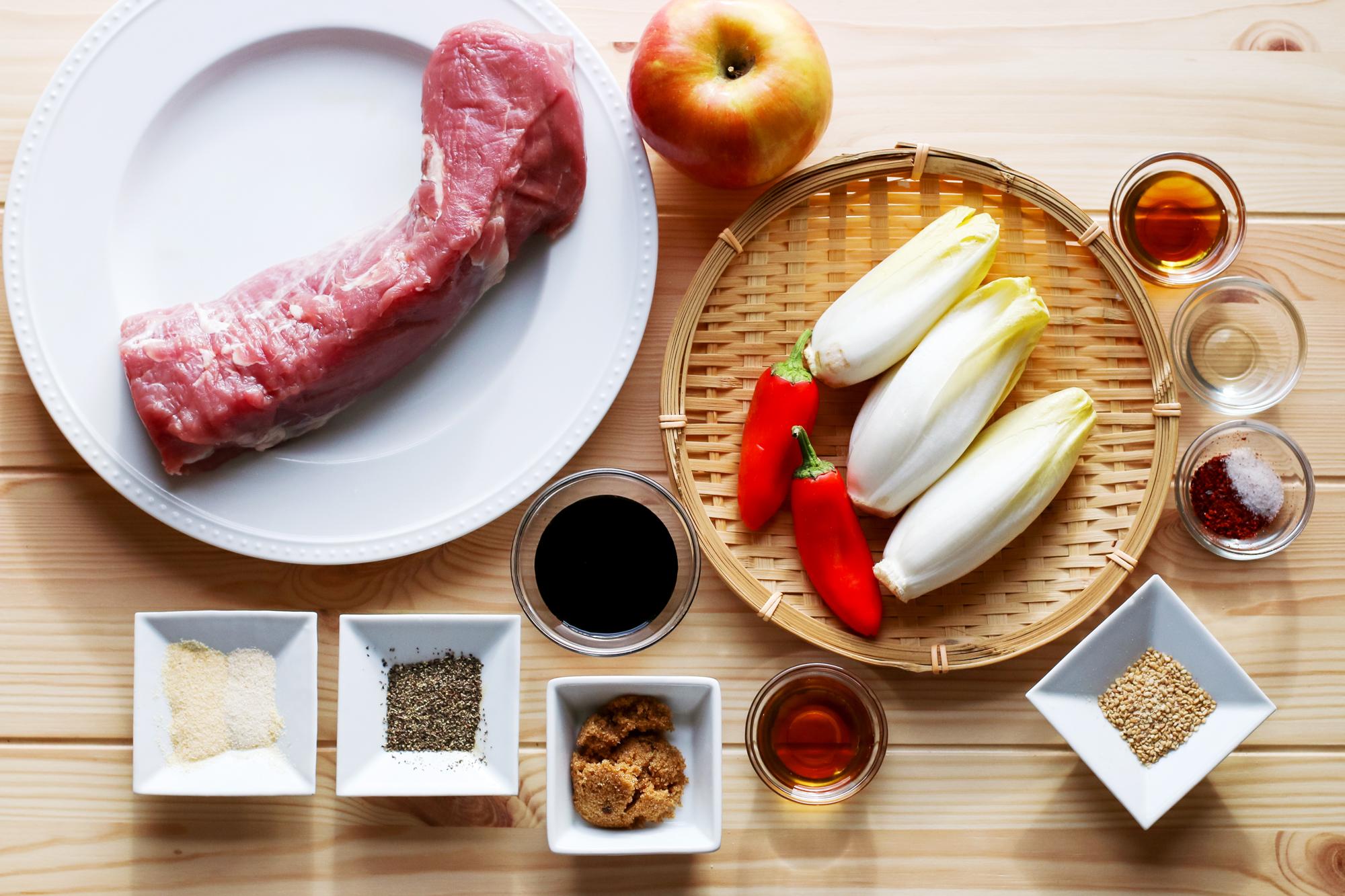 The ingredients: pork tenderloin, endives, Fuji apple, small red chili, sesame seeds. For the marinade, soy sauce, sesame oil, brown sugar, black pepper, garlic granules, onion granules. For the salad dressing, sesame oil, rice wine vinegar, gochugaru (Korean red pepper flakes) and salt.