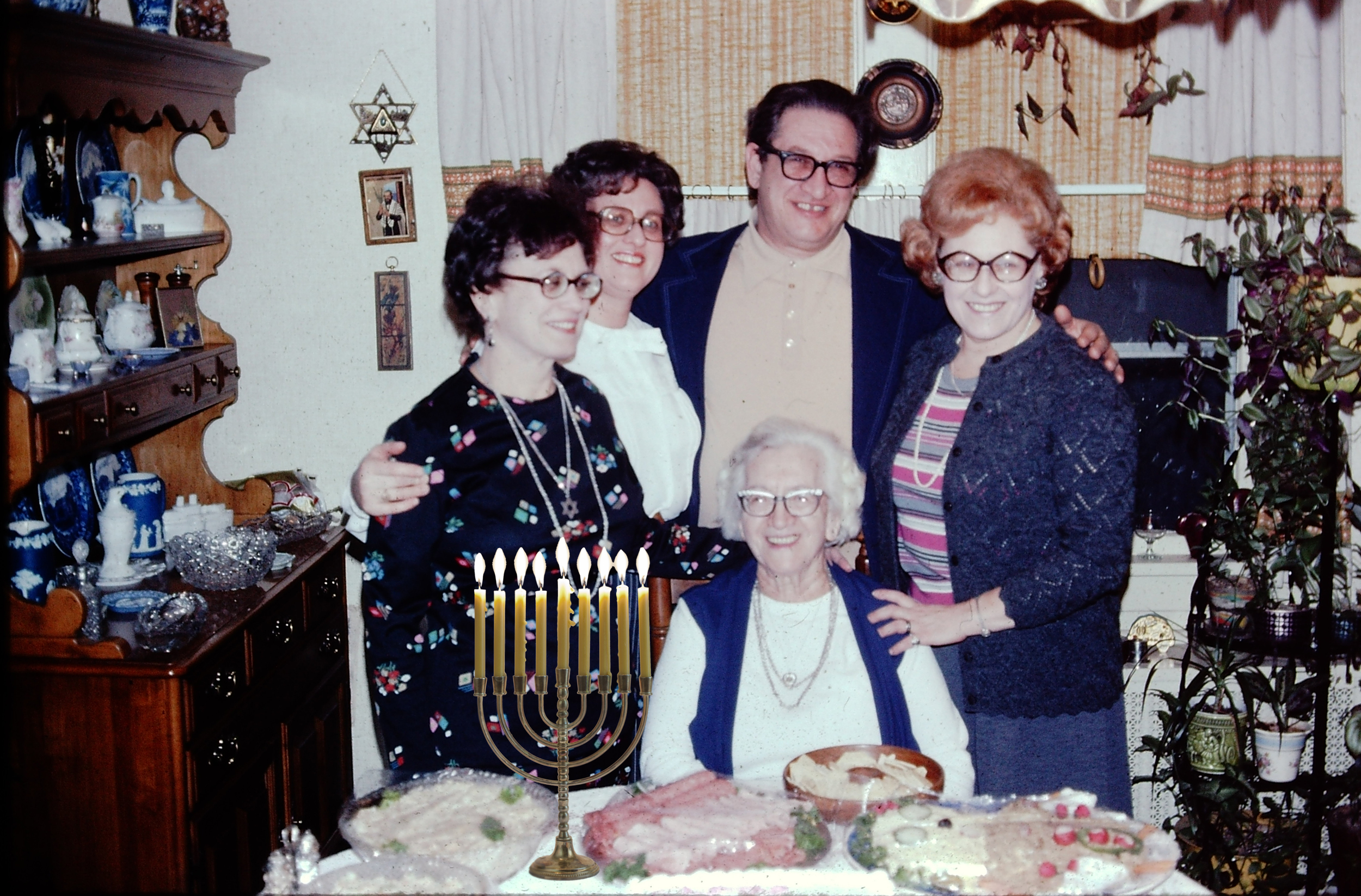My great-grandmother with some of her children, including my bubby (second from the left). Menorah placed for conceptual purposes only :)