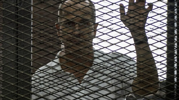 Grim news: Australian Al Jazeera journalist Peter Greste hears the verdict from inside the defendents' cage.  Via: Sydney Morning Herald.
