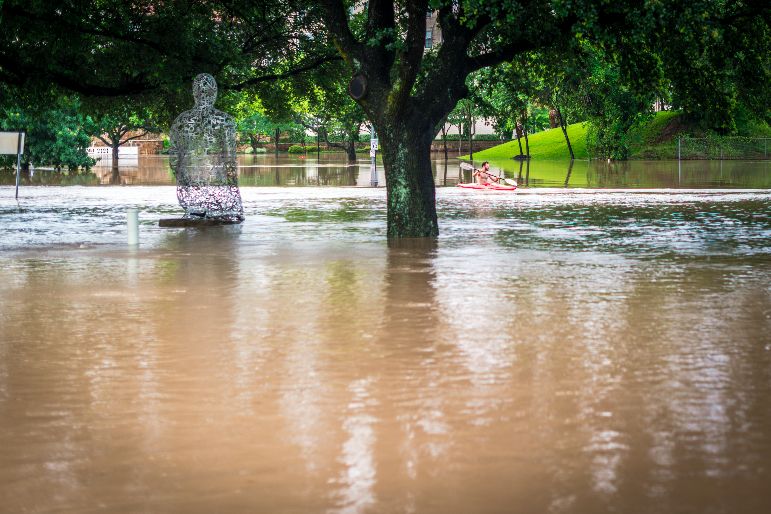 Here, the same kayaker is paddling on Allen Parkway, a street usually humming with cars, on May 26, 2015.