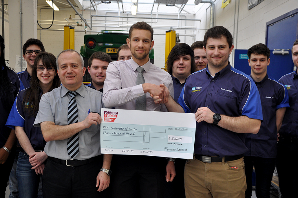 From left to right: Ilias Oraifige (Deputy Head of Department - Mechanical and Manufacturing Engineers), Fabian Welford-Tuitt (IMechE), Andrew Menzies (Team Leader, Team Derby Motorsport)