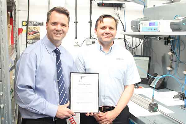 Tidyco's production manager, Phil Mason receiving the Pneumatic cylinder manufacture approvals certificate from Dean Taylor of Parker Hannifin