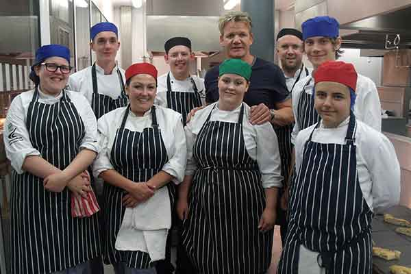 Gordon Ramsay pictured with student chefs at Derby College