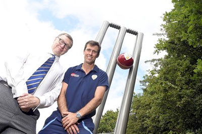 Gareth Cure, left, chief executive of Briggs of Burton, and Wayne Madsen, club captain, inspect the stumps.