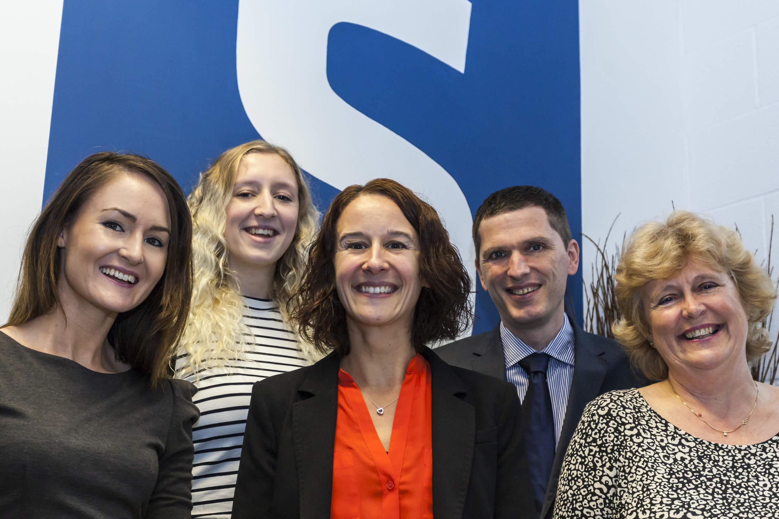 Smiles all round the team at Status Social