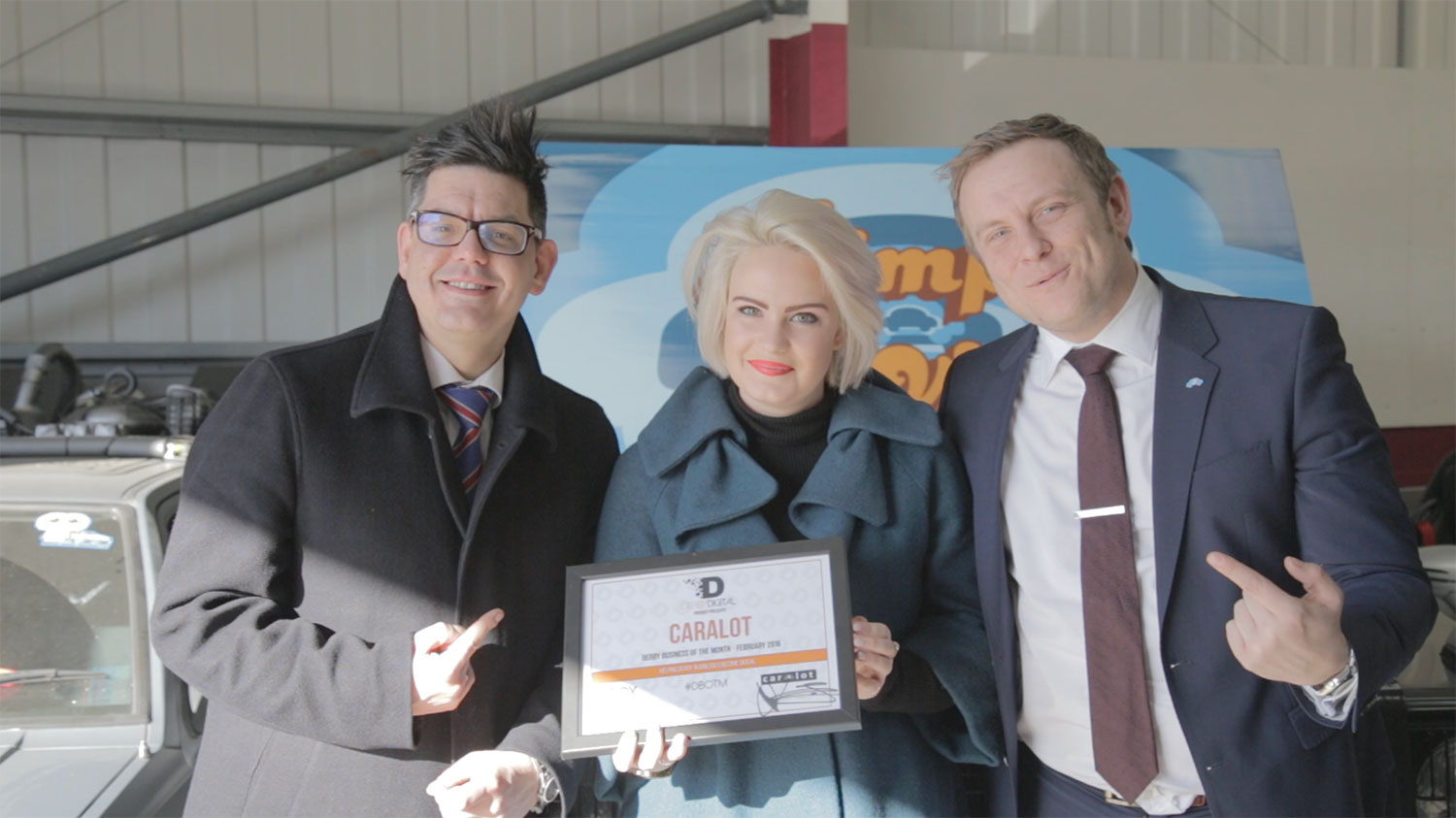 Harriet Taylor (middle) presenting the Caralot team with their Derby Digital Business of the Month award
