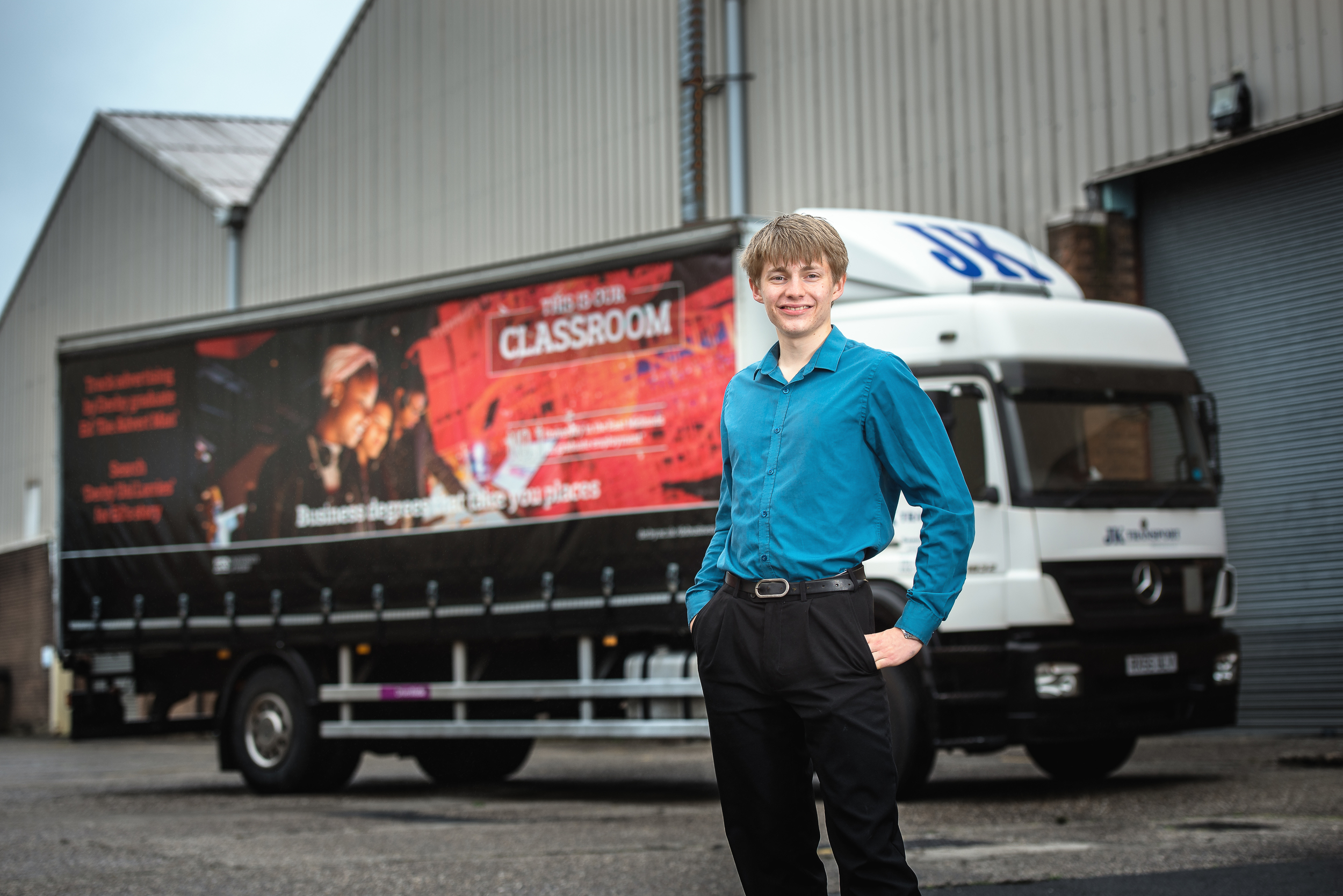 Ed Hollands, in front of one of his innovative lorry adverts