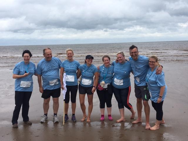 Group on beach all smiles.jpg