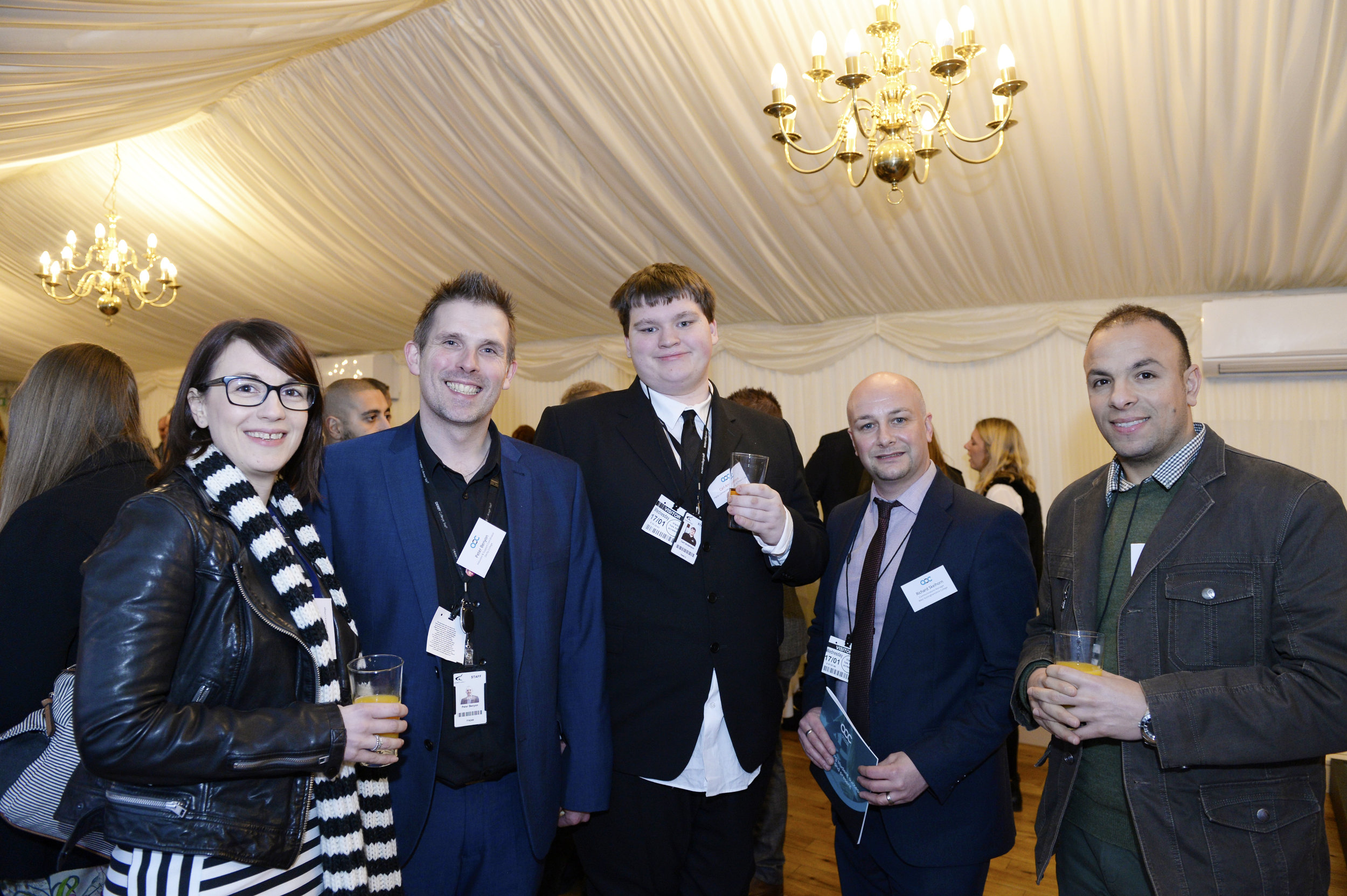 Carl Anderson, centre, and Peter Benyon, second left, with fellow guests at the celebration reception.jpg-orig.jpg