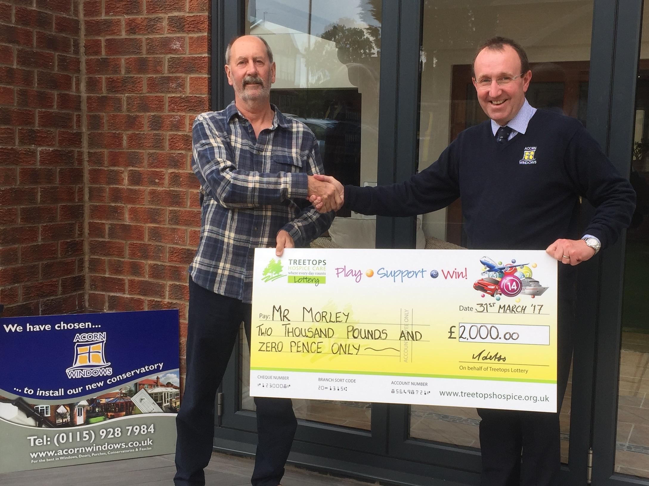 Super Draw winner 2017 with bumper prize cheque.JPG