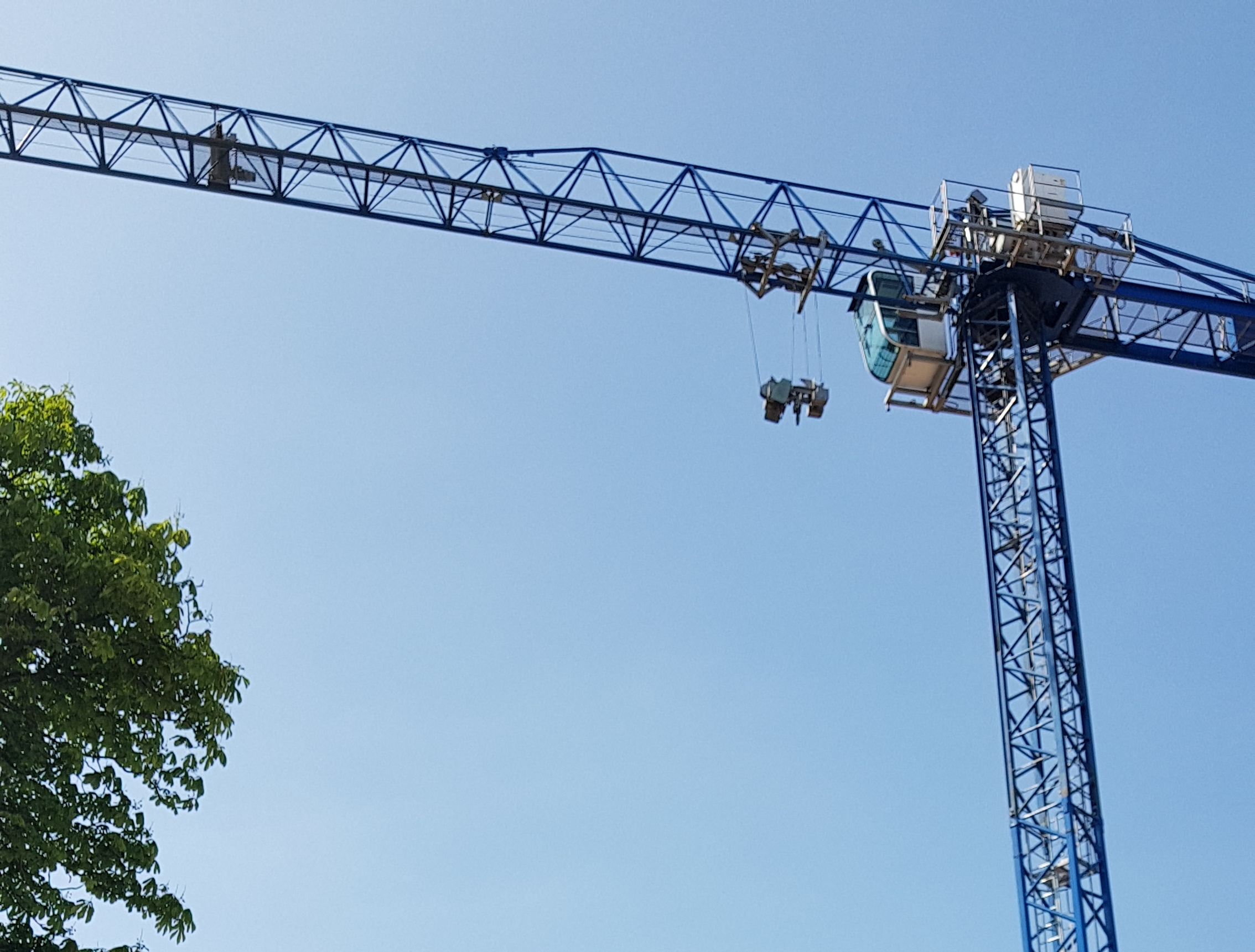 Crane hangs high over the site.