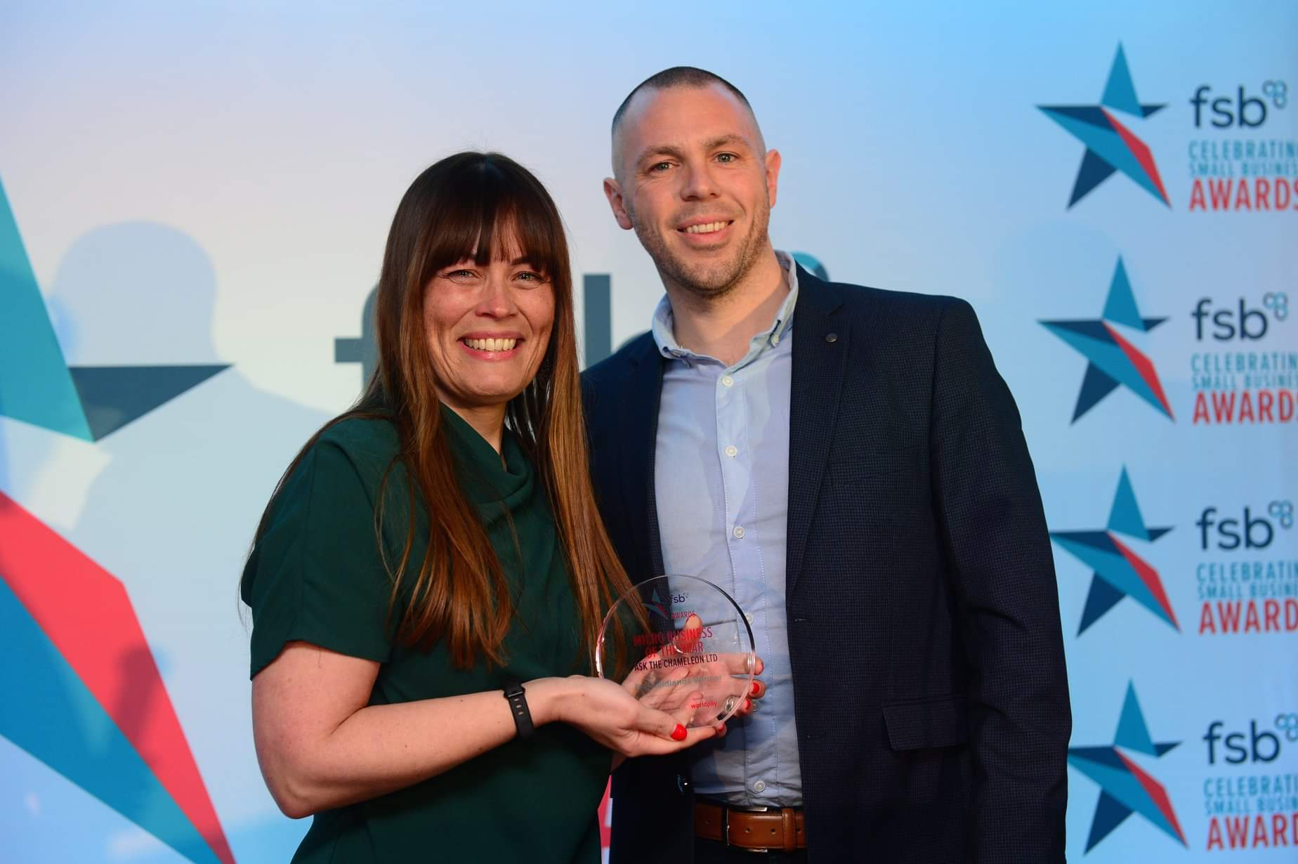 Rachel_Hayward,_Ask_the_Chameleon_receives_award_from_category_sponsor_Tom_Wade,_Regional_Business_Manager_for_Worldpay.jpg