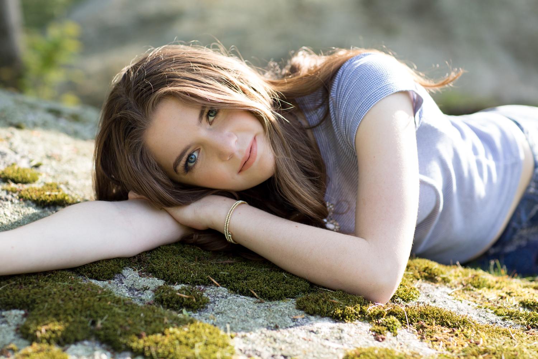 girl-laying-moss-covered-rock.jpg
