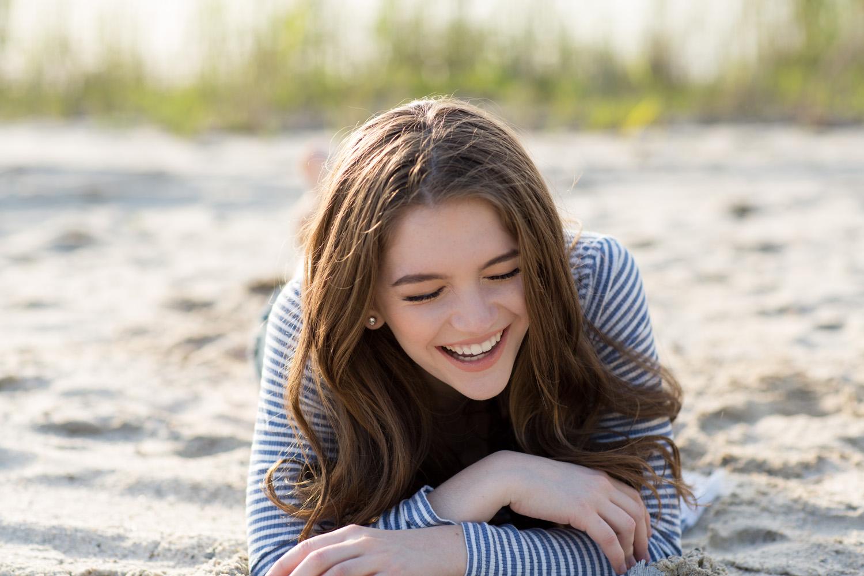 girl-laughing-sand-sunset.jpg