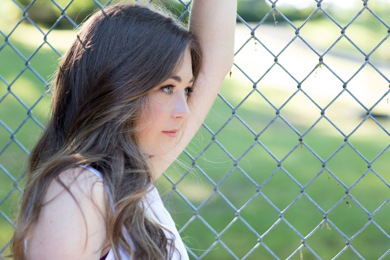 girl-fence-blue-eyed.jpg