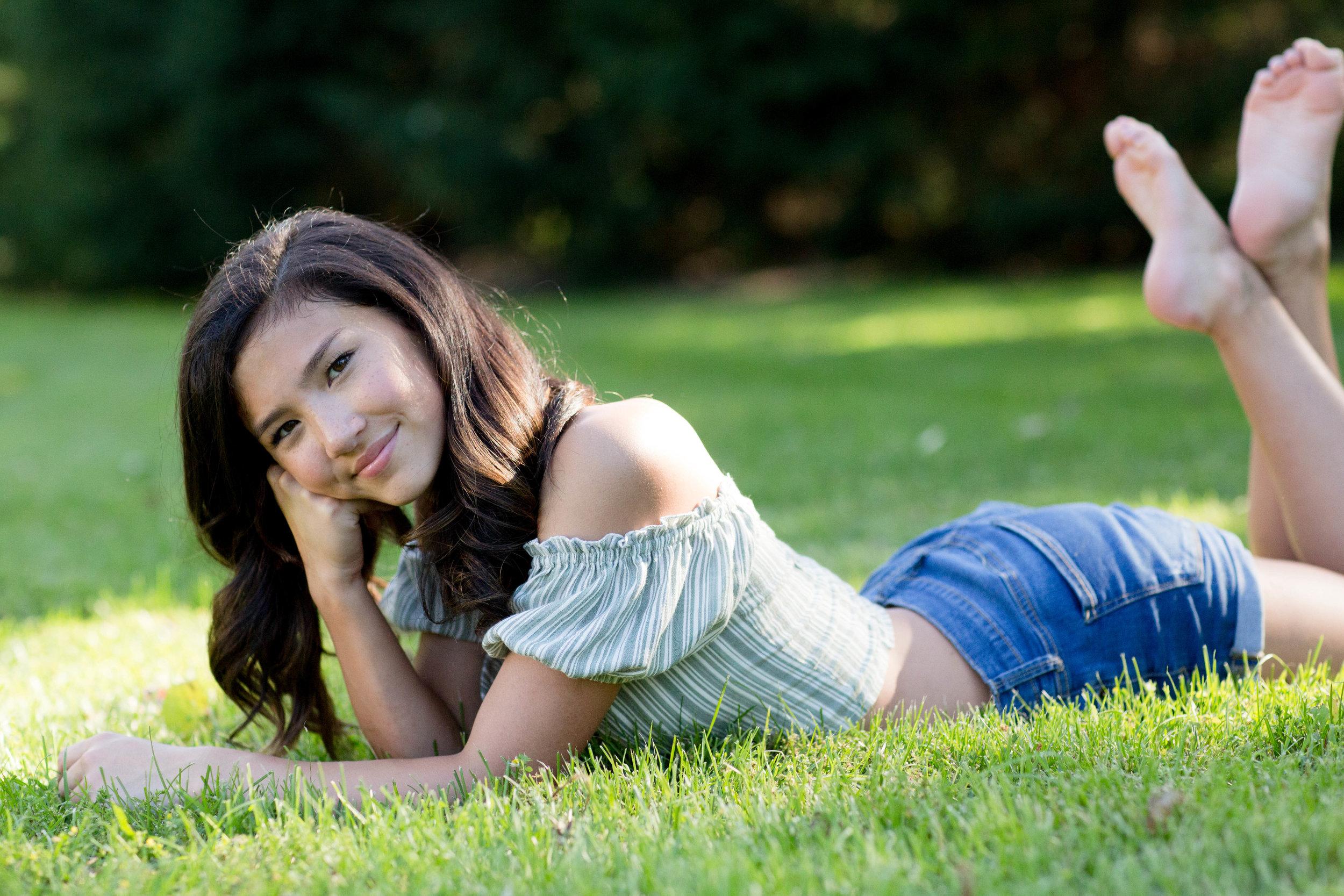 teen girl in grass.jpg