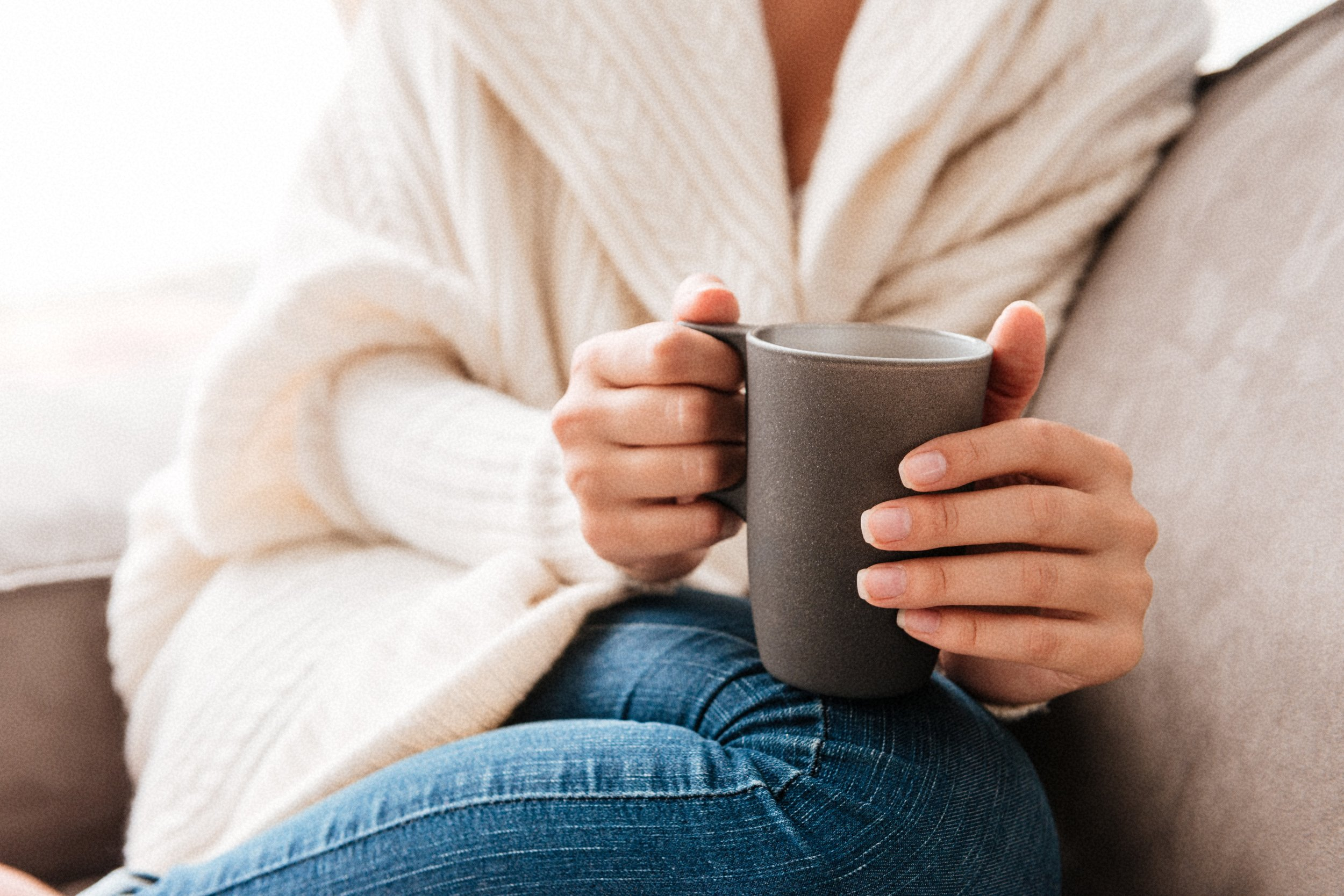 Canva - Woman Sitting and Holding Cup of Coffee on Couch (1).jpg