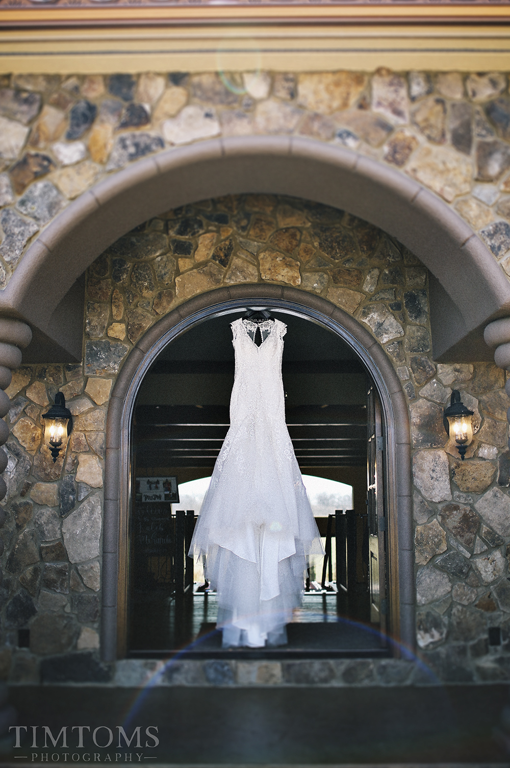 White Wedding Dress Hanging in Door