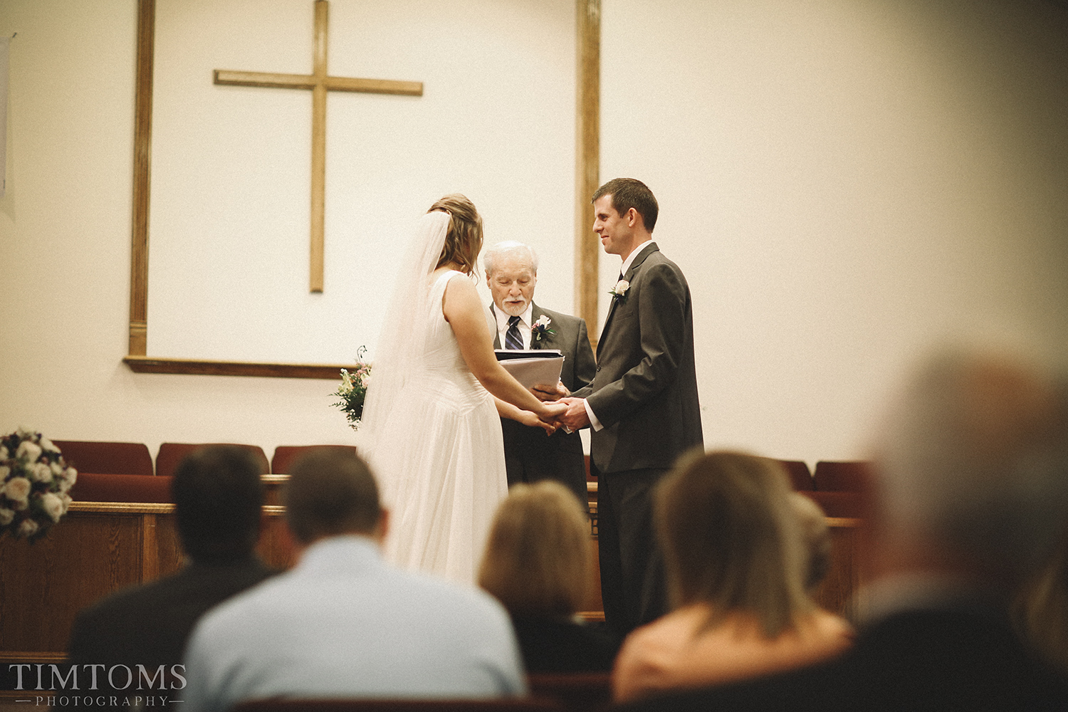 Bride and Groom wedding at the altar i do