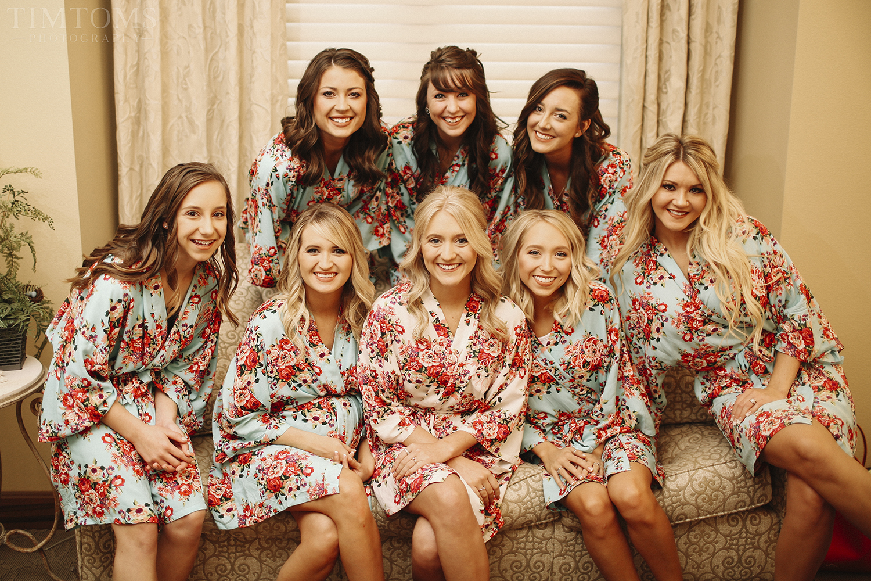 Bridesmaids pre wedding in robes sofa