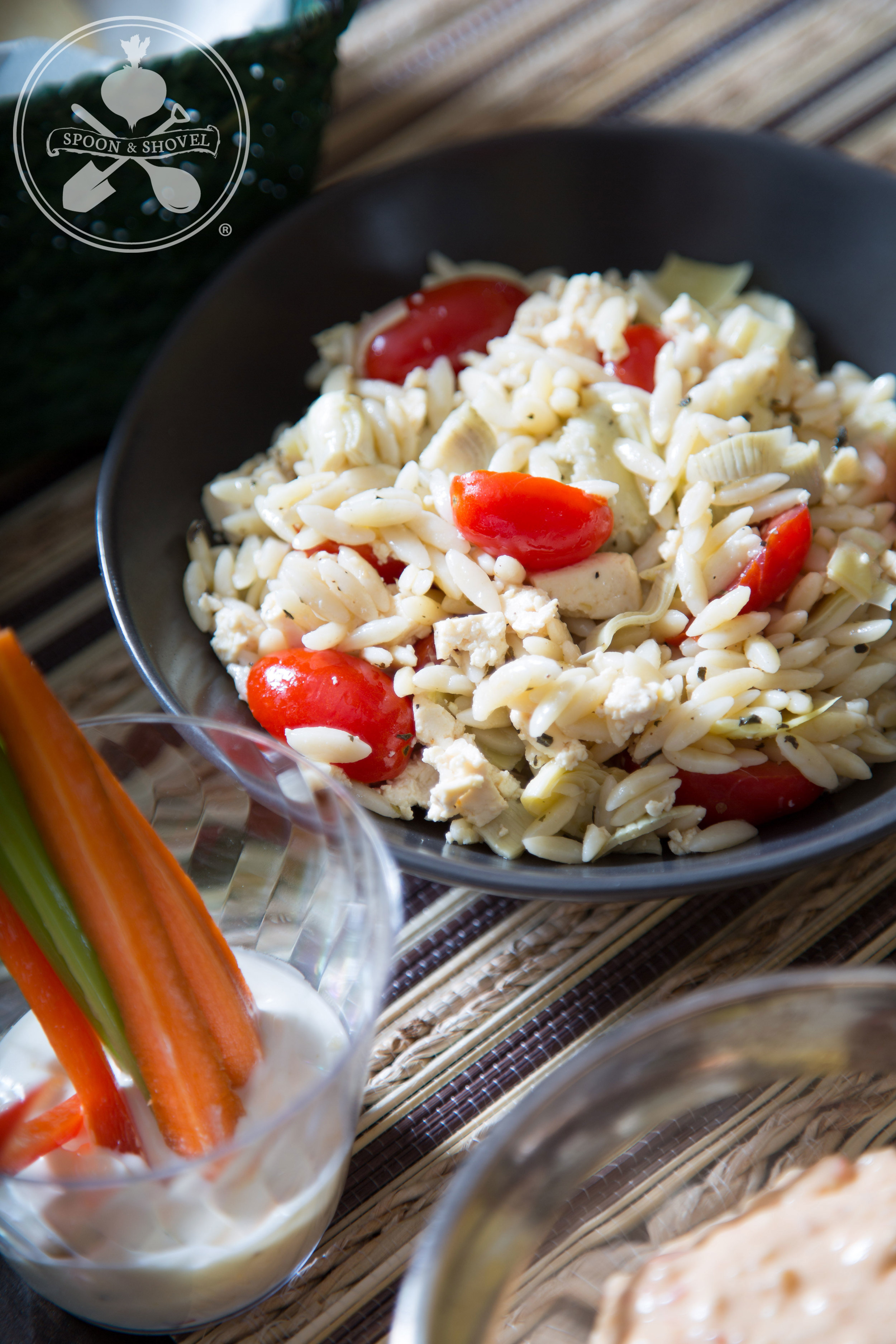 Tomato, vegan feta and artichoke orzo salad (with ranch cups in the foreground)