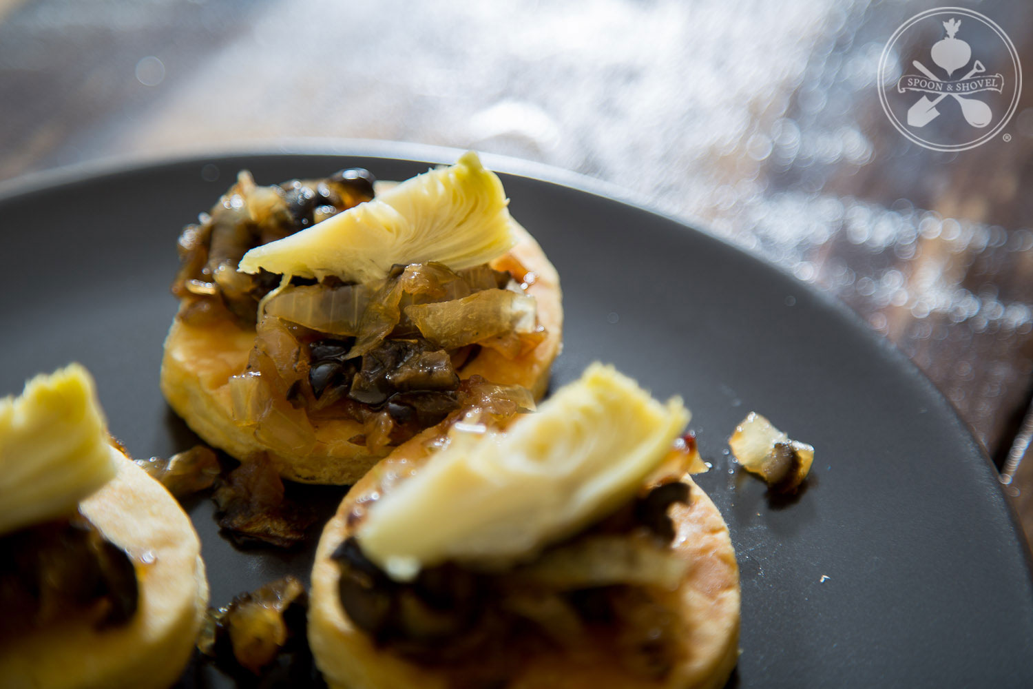 Caramelized onion and artichoke tarts from The Spoon + Shovel