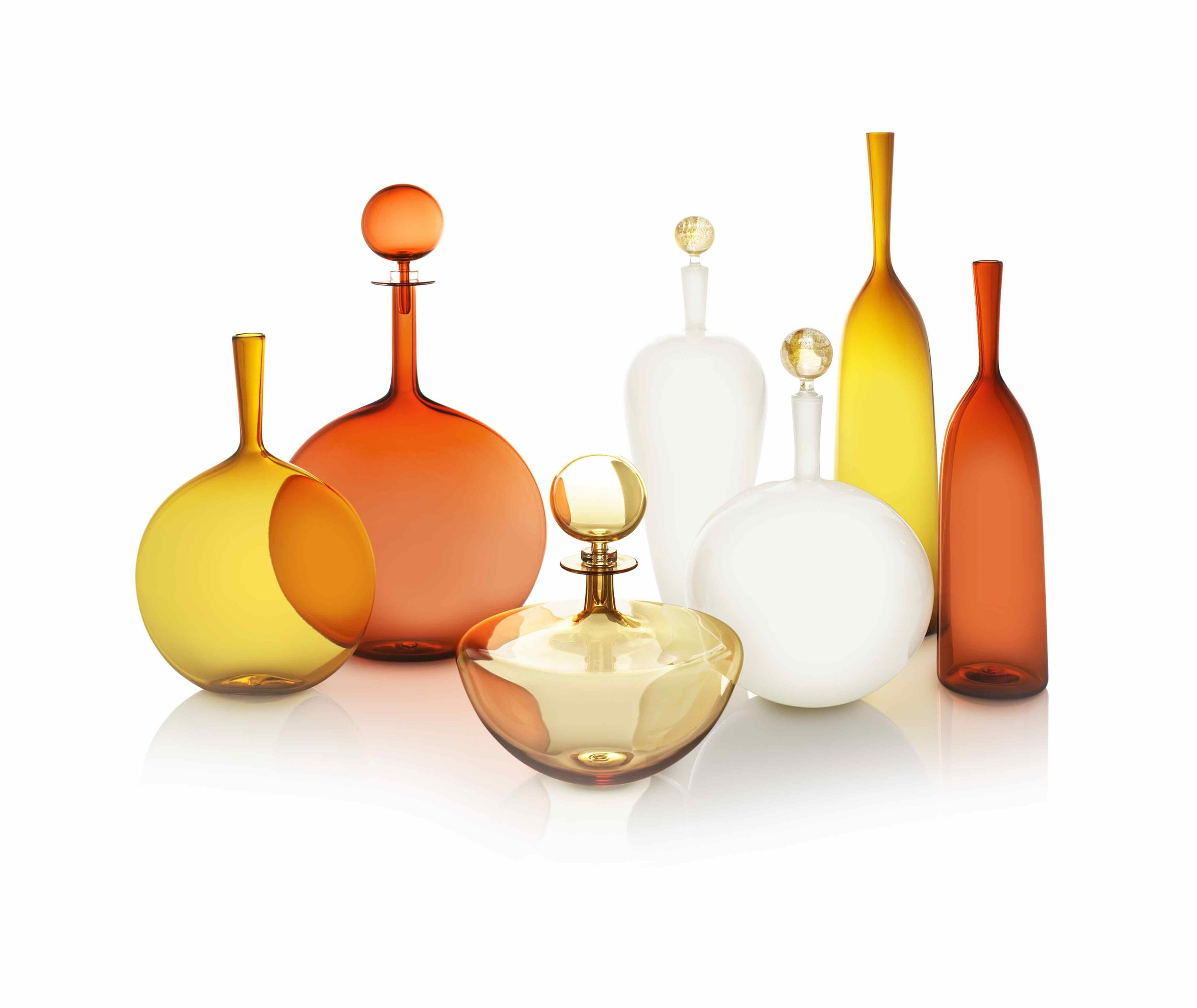 SUNSET GROUPING: ANGELIC FLASK AMBER, LARGE DECANTER FLASK APRICOT, PETITE DECANTER LOW ARC WHISKEY, CARMELLA HIGH SHOULDER & LOW ROUND IN IVORY, LARGE ANGELIC AMBER, SMALL ANGELIC APRICOT