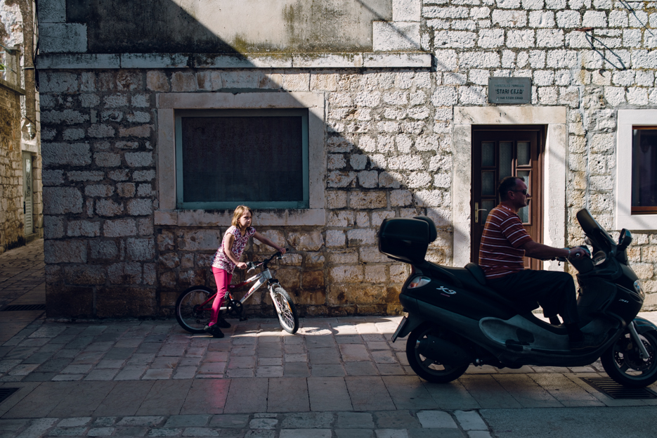 """There were a lot of children playing on the streets of Stari Grad. They shared the """"roads"""" with passing vehicles."""