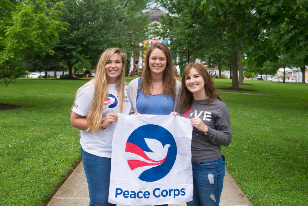 Peace Corps-bound graduates (left to right) Dakota Shepherd, Hannah Wolf, and Caitlin Tolley.