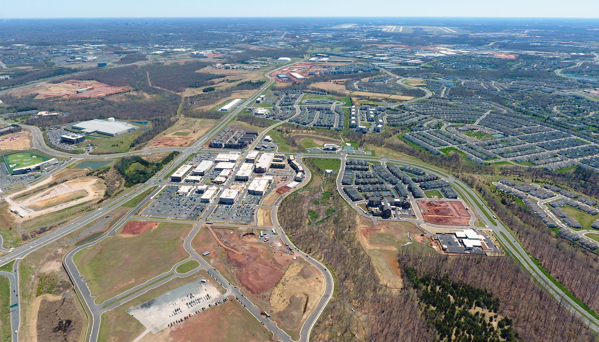 April 2018 aerial view above site looking south over the One Loudoun master plan and Dulles Airport beyond