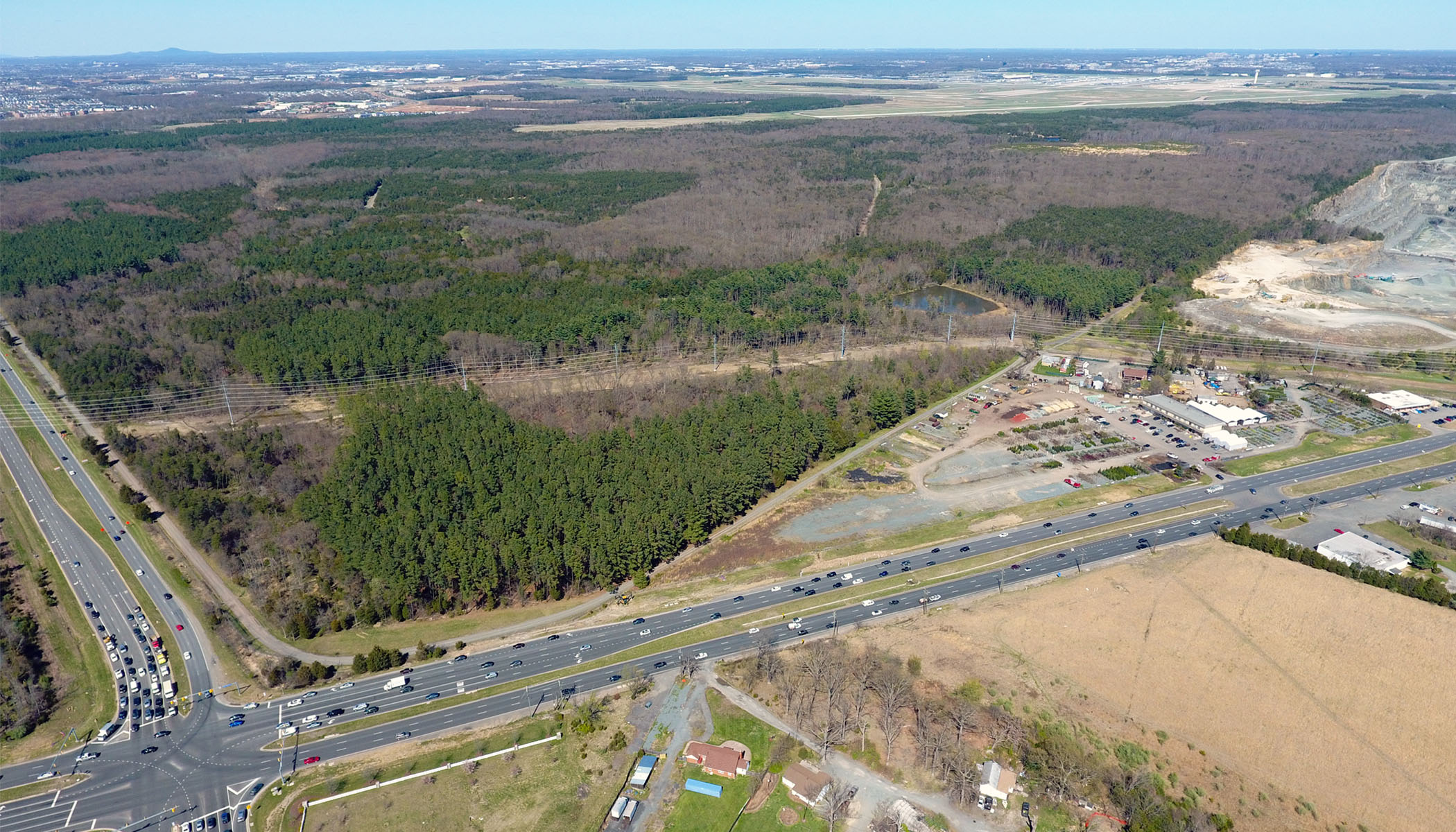 April 2018 aerial view toward the site, the intersection of US Route 50 (John Mosby Highway) and Loudoun County Parkway (VA-606) with Dulles Airport beyond