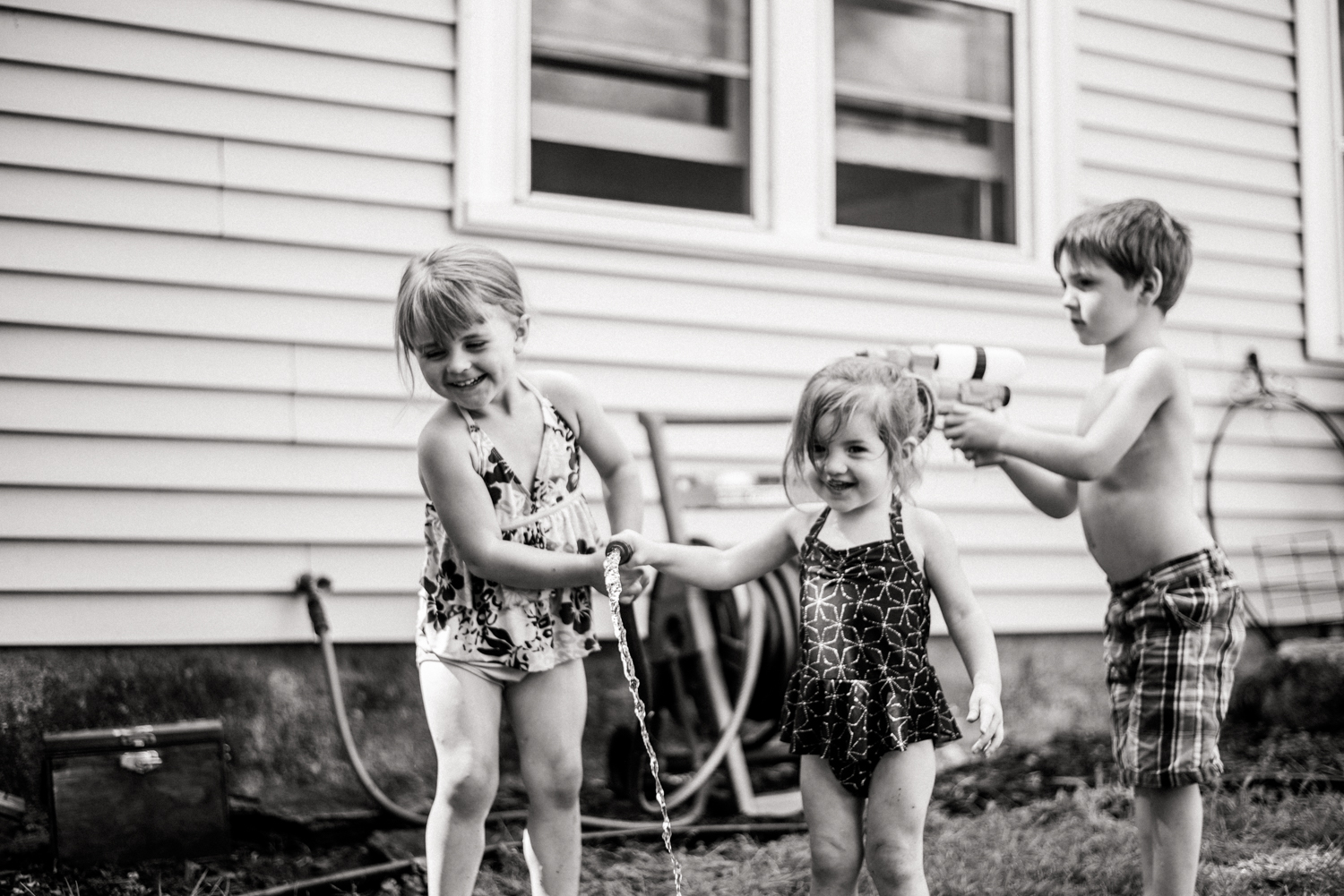 kids playing with the hose