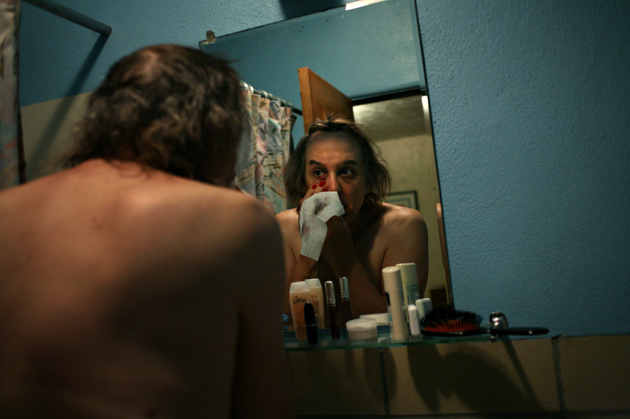 Elena washes the makeup from her eyes in a hotel bathroom in Trinidad, Colo., on the night before her genital reassignment surgery.