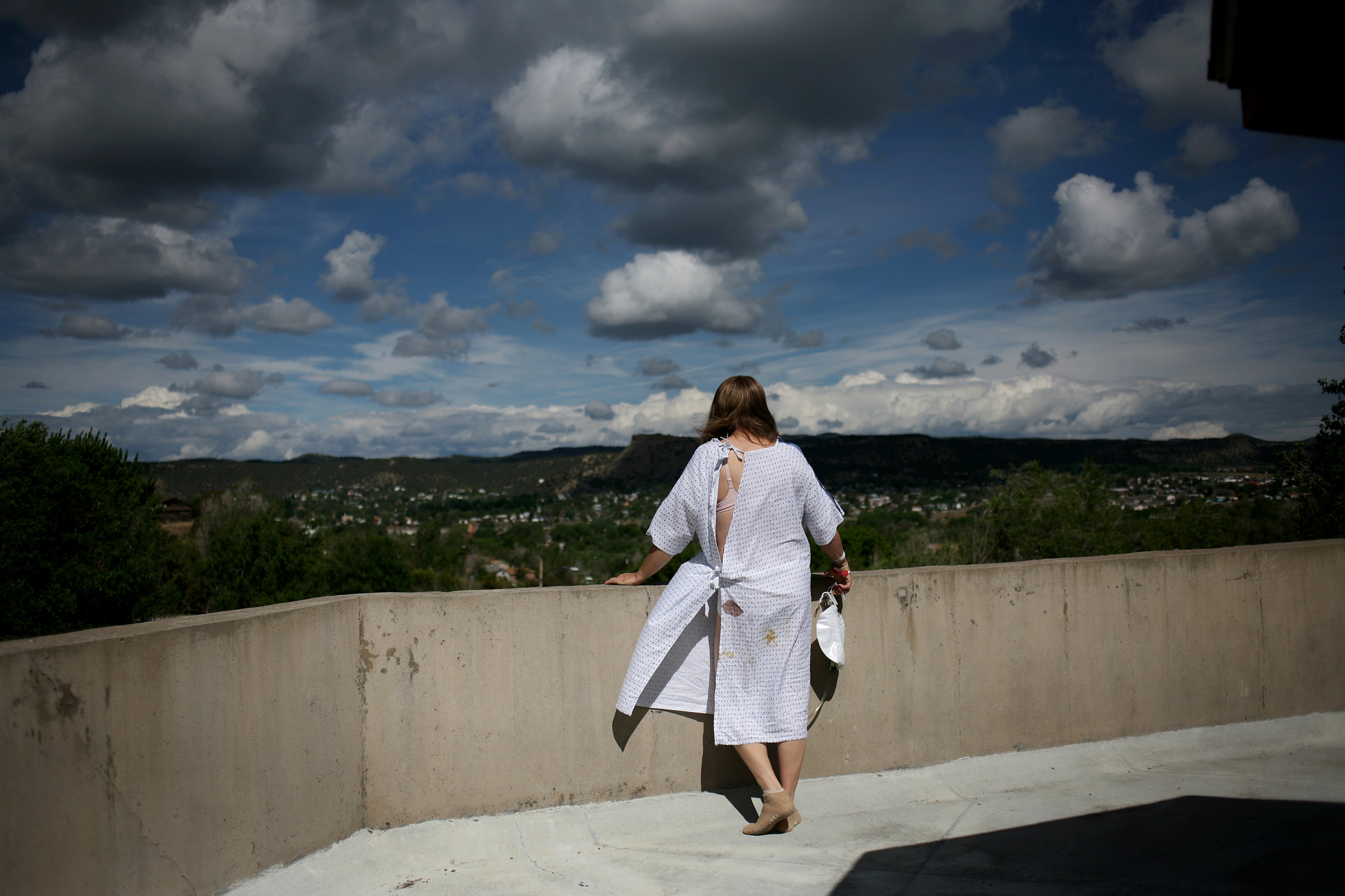 """Elena peers out over the view of Trinidad, Colo., during her recovery at the hospital post-surgery. Many people warned her that transitioning from a male to a female will be hard, both physically and emotionally, but she always responds with a big smile. As she explains, the struggles she may face because of her choices are nothing compared to the feeling of freedom to finally be herself.  """"I'm overwhelmed every day with the reality of what I'm getting to live right now."""""""