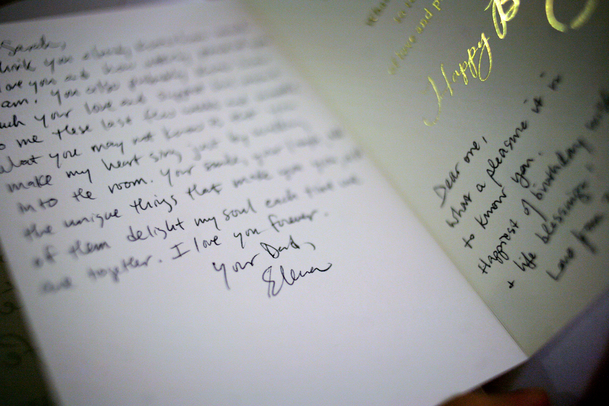 """Elena finishes writing a card to her oldest daughter, Sarah, for her 26th birthday. She sees herself as a woman, but understands she still plays the role of a father in the lives of her children. While in daily life it irks her when others refer to her as """"sir"""" or """"mister,"""" she still welcomes the male terminology of """"dad.""""  """"I am their father, there's nothing I can do to change that,"""" she says. """"There's no reason to change it."""""""