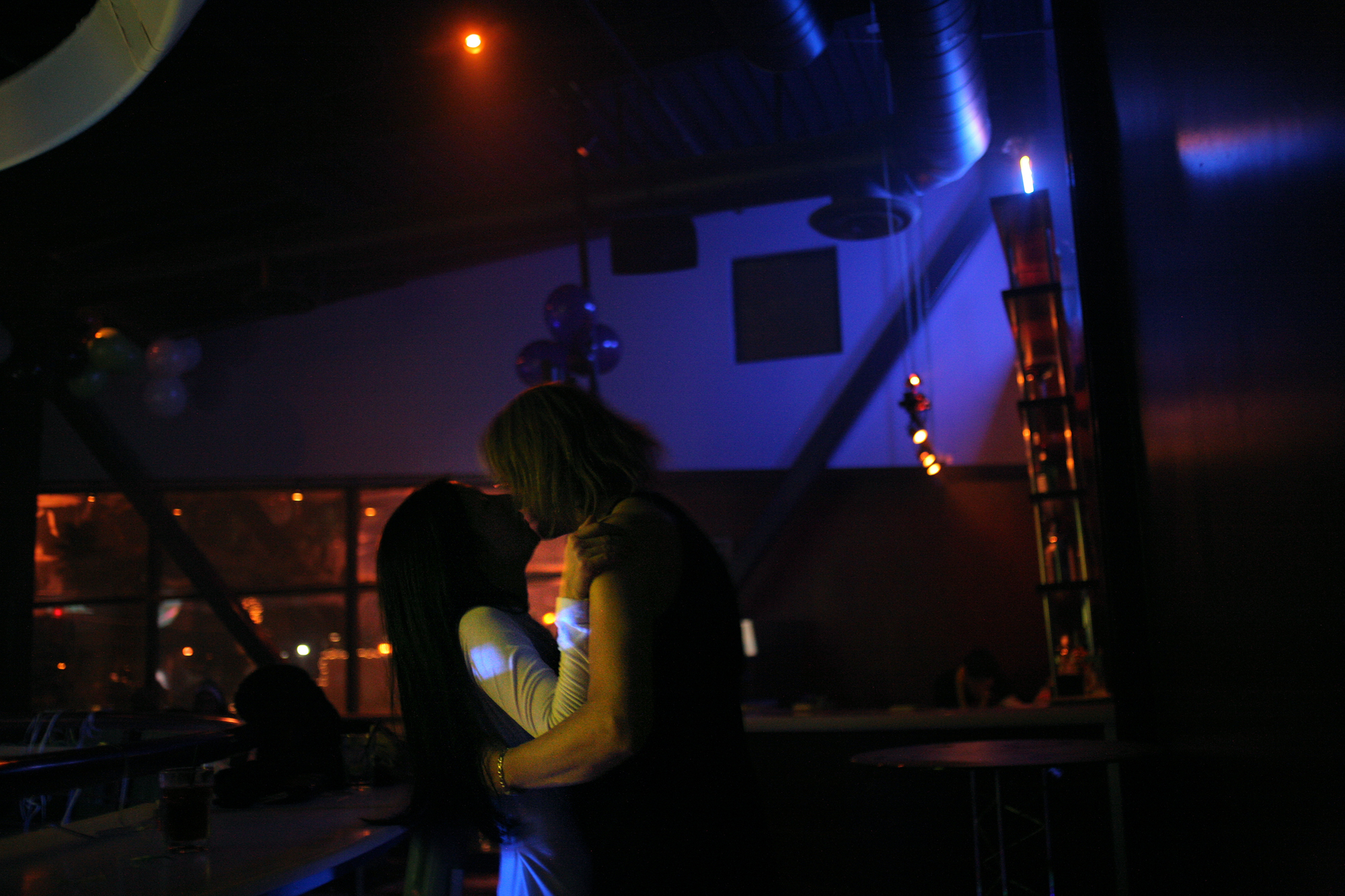 Elena celebrates New Year's with her friend Anna at Faces, a popular gay bar in midtown Sacramento. The two spent the night dancing, drinking, and sometimes kissing in the dark of the club's upper level.
