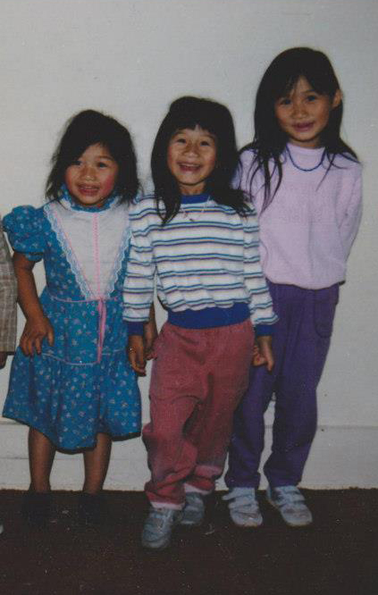 Me (left) with my super cute first-generation older sisters. 1990s.