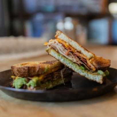 Guactastic - Crispy Bacon, Sliced Turkey, Guacamole & Cheddar Cheese on Toasted Sourdough.Half/Full - $6.50/$10.95