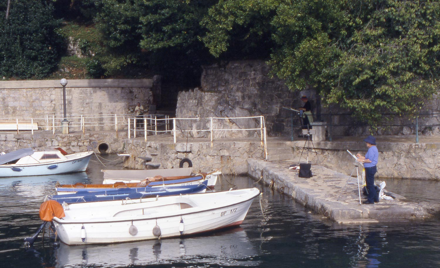 D. Painting, Opatija  In this case, reflection of the white boat is a light tone surrounded by darker water. I hope my student in the photo captured it!