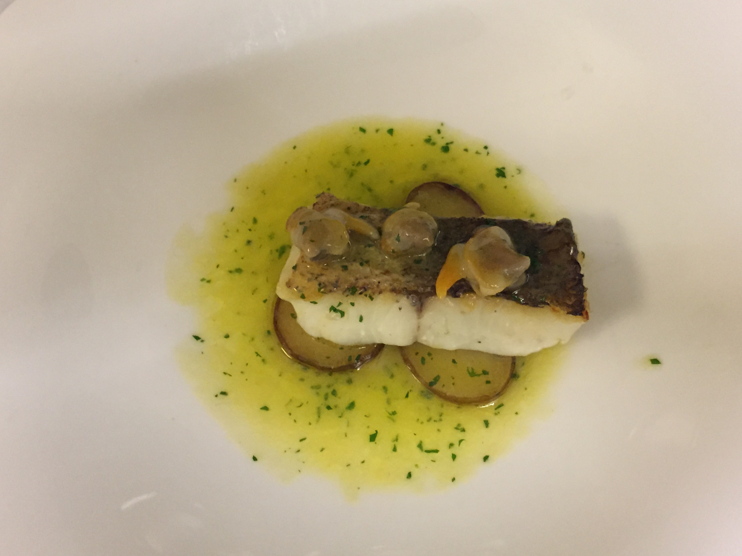 Hake Confit  With Roasted Potatoes and Small Clams