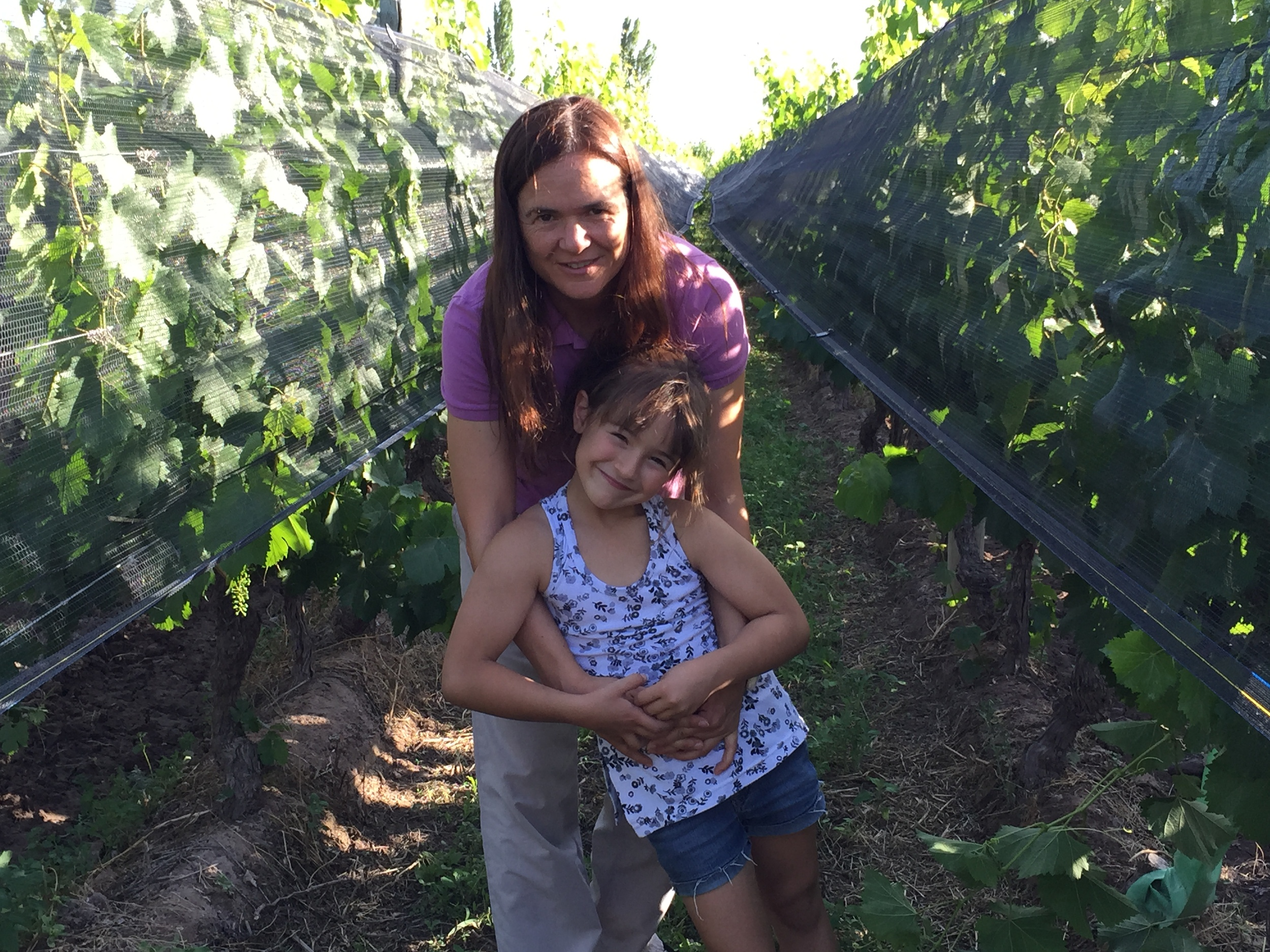 Andrea Marchiori of Marchiori and Barraud, with her youngest daughter, in the family's vineyards.