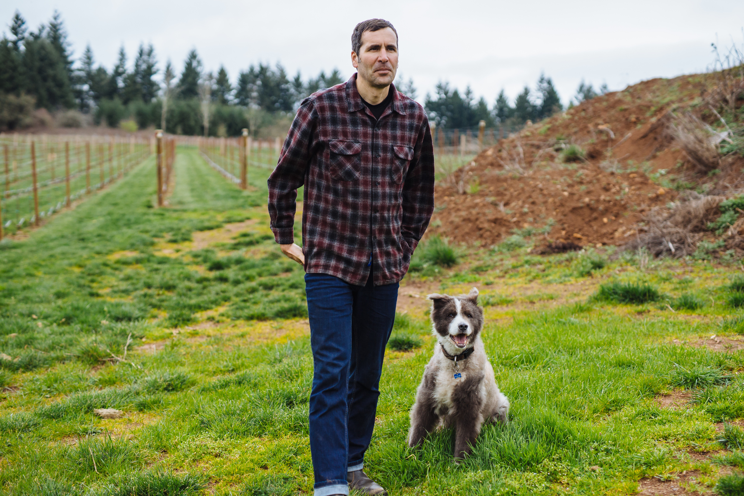 GC John & dog in vineyard.JPG