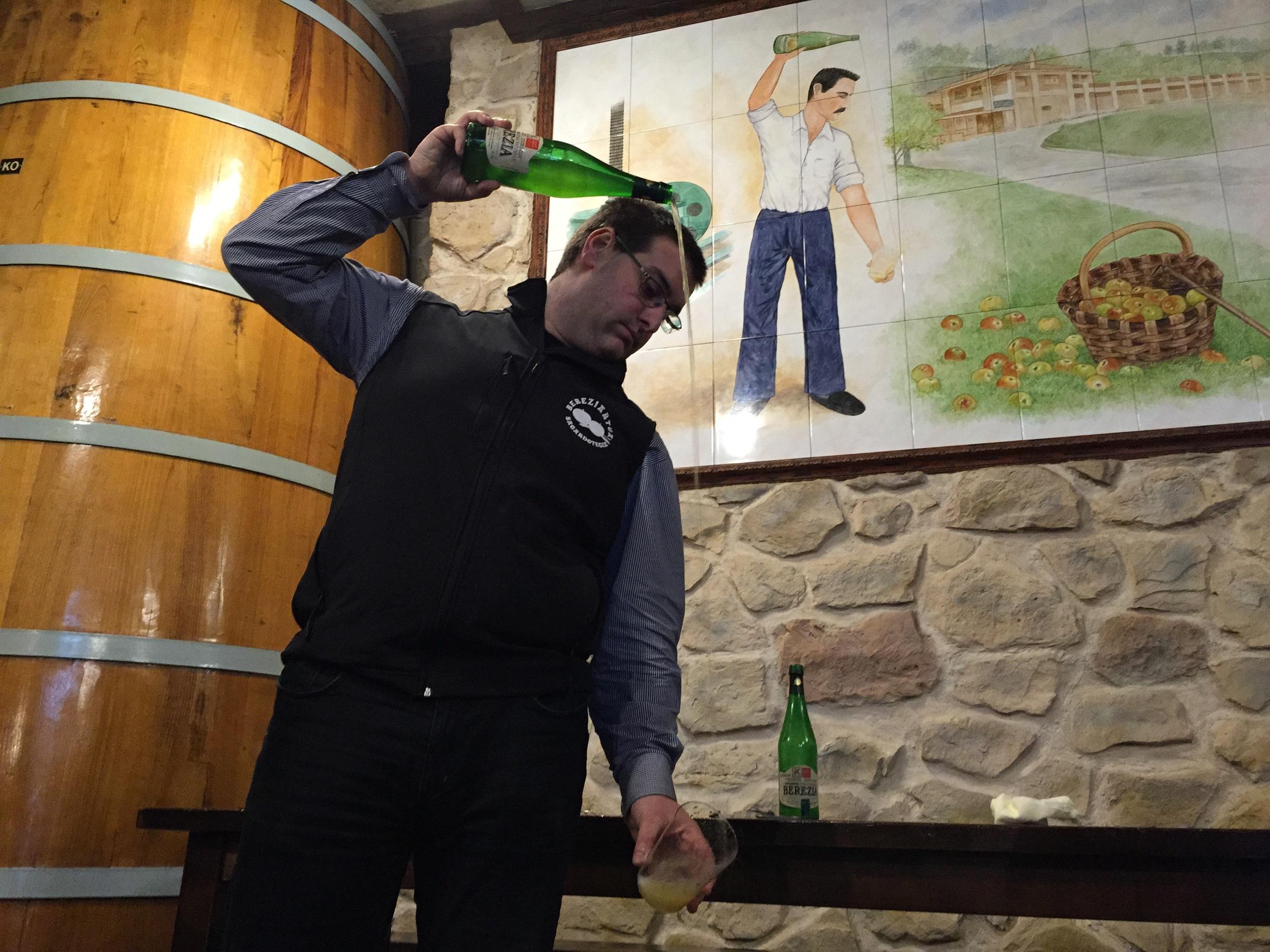 Fourth generation cider maker, Aitor Bereziartua, demonstrates his escanciar technique.
