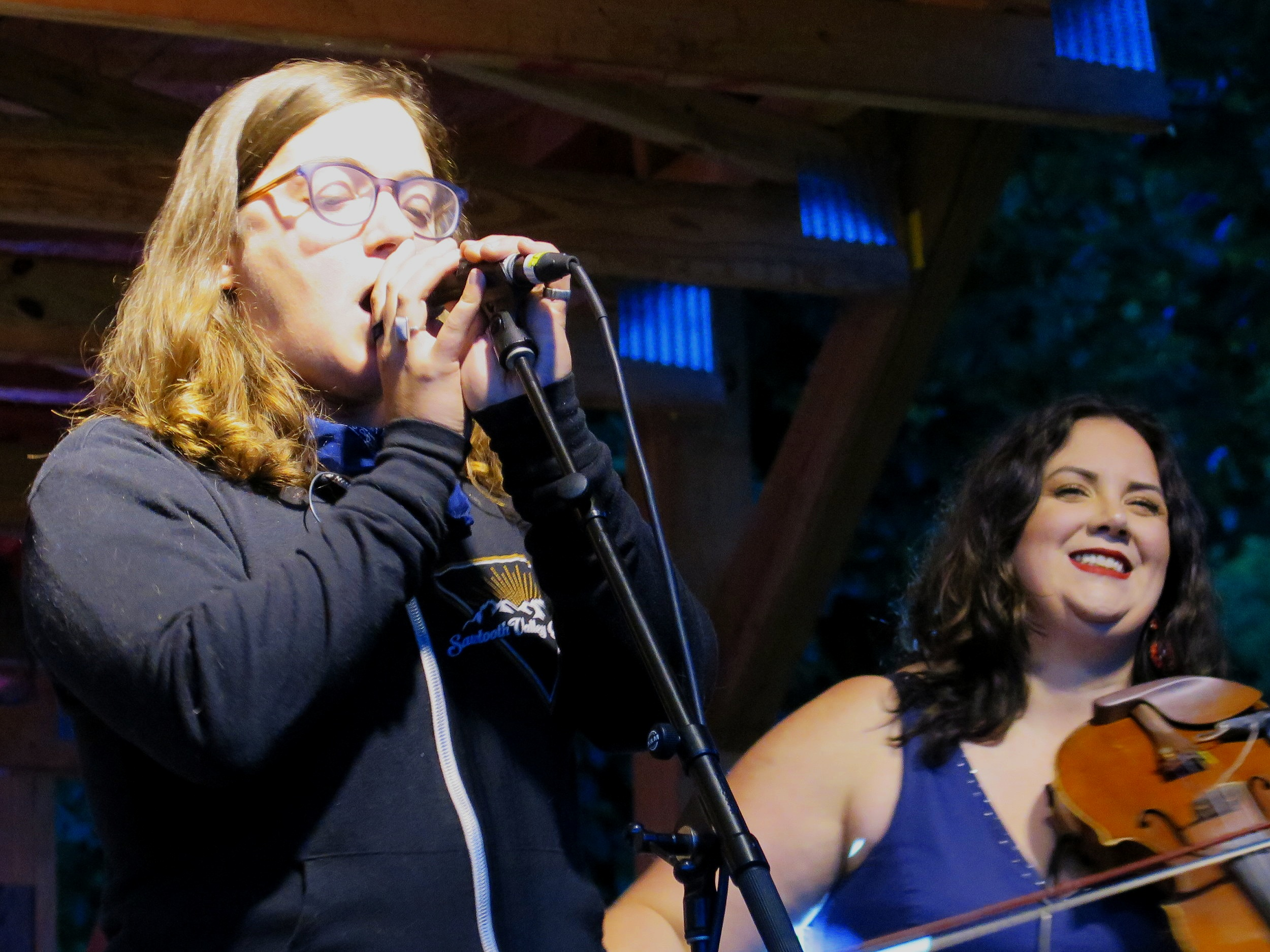 """Mimi Naja of the band Fruition sings """"White Rabbit"""" as Allie Krall of Yonder Mountain String Band plays fiddle at Cold Mountain Music Festival 6-1-19"""