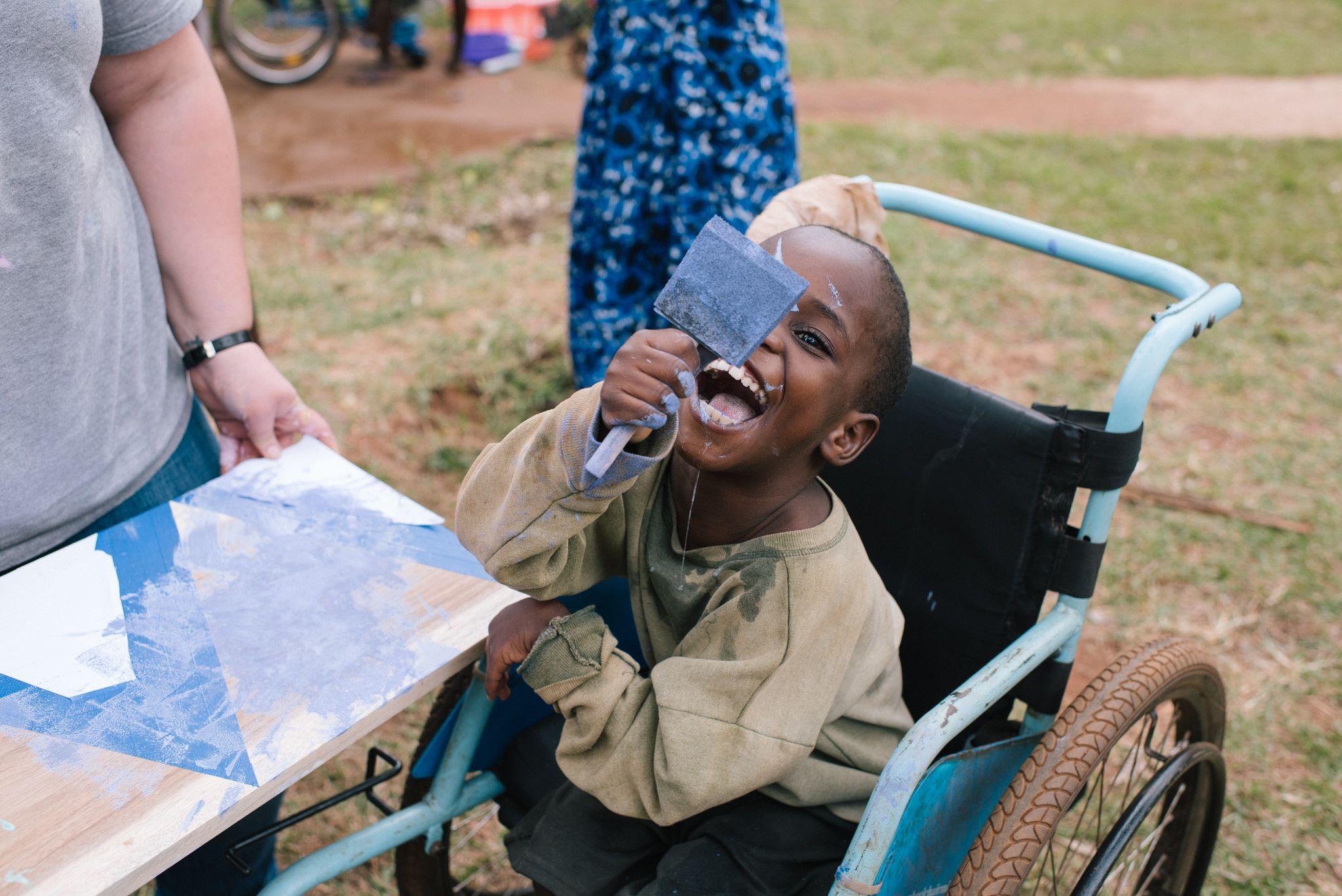 Lawrence, having a ball.  Photo credit Ekisa Ministries