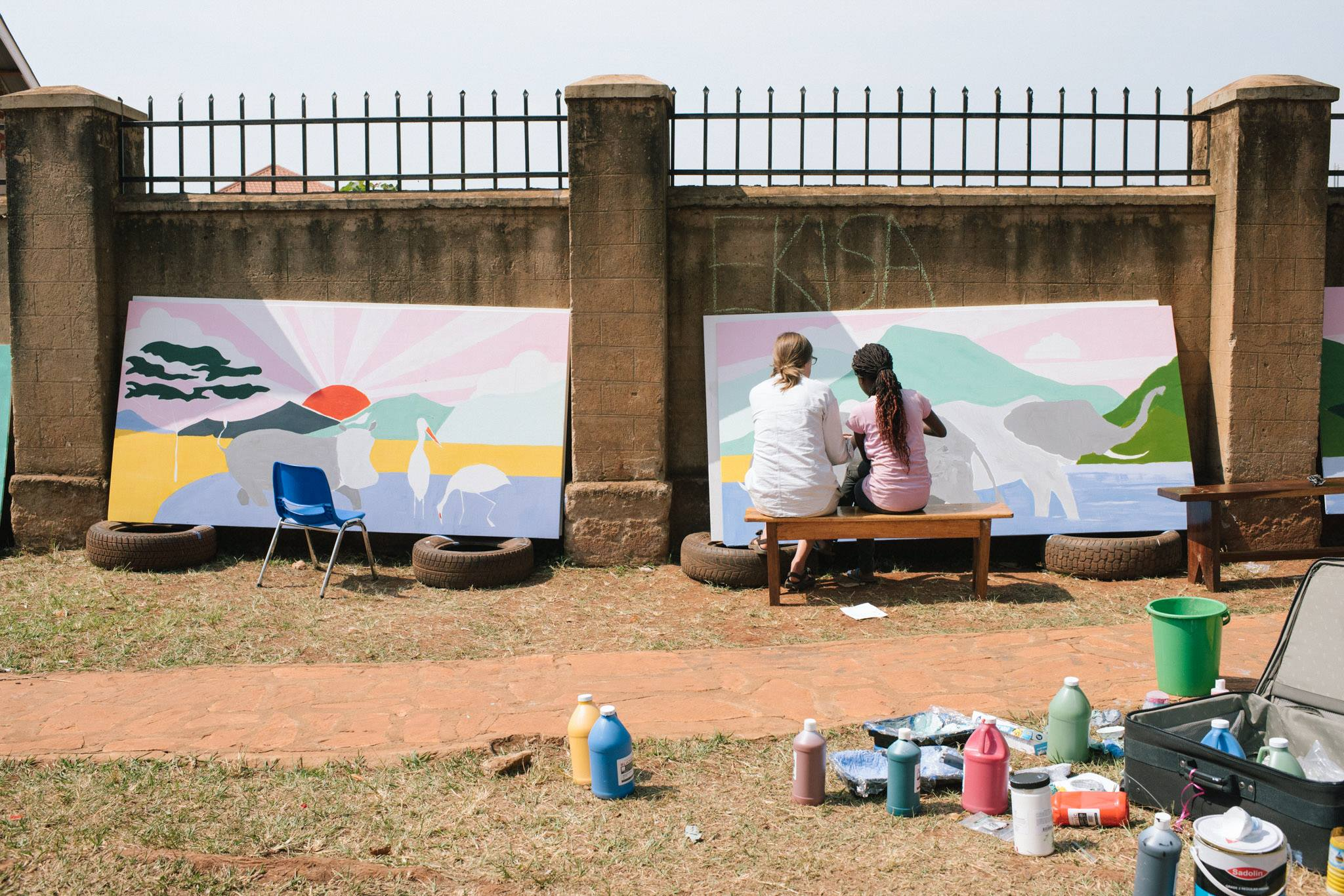 Painting elephants with Blessing. Photo credit Ekisa Ministries