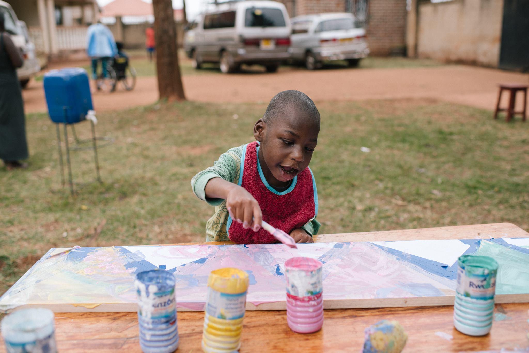 Jackson, focused on his piece. Photo credit Ekisa Ministries