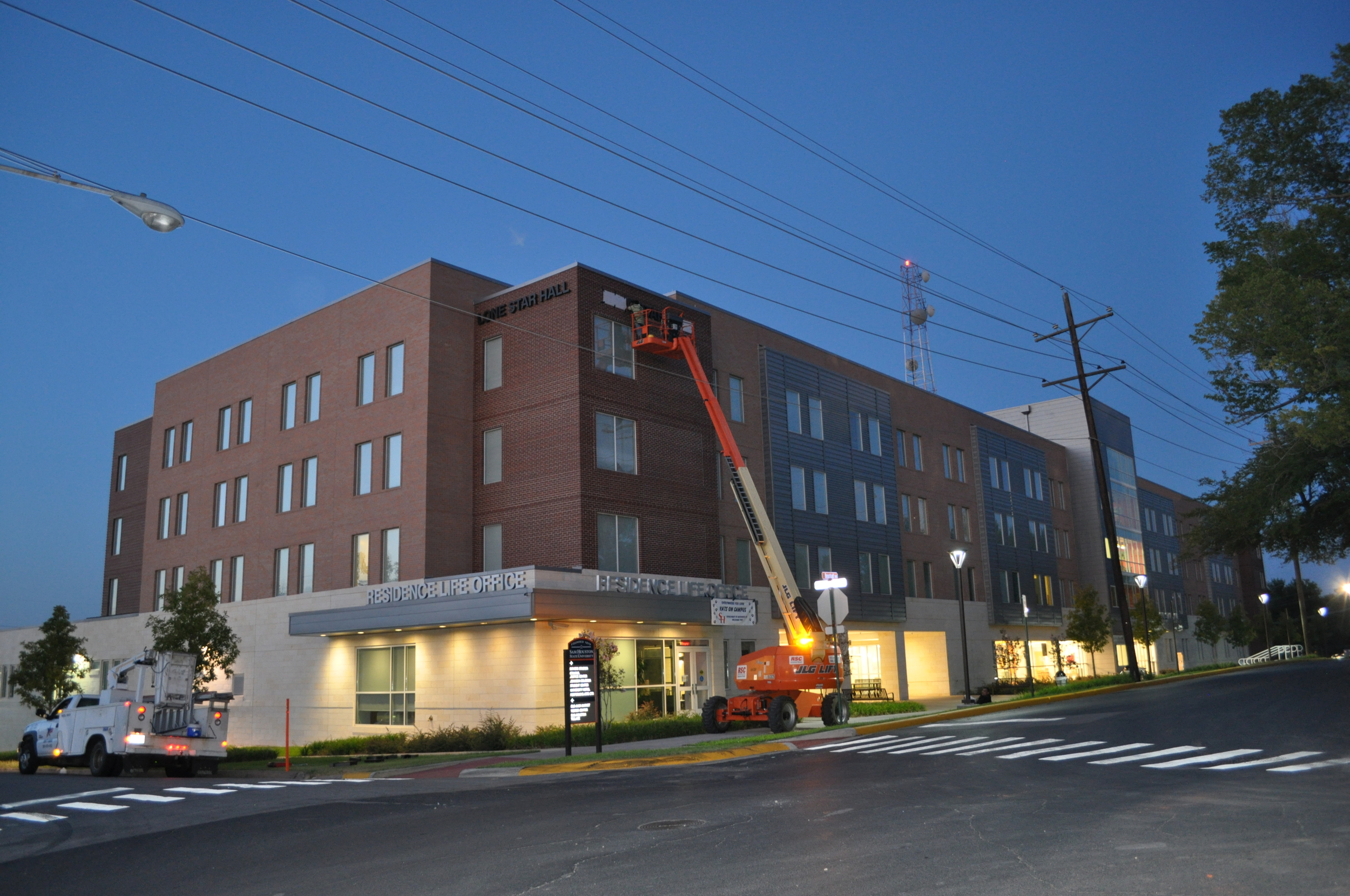 "<font size=""4"" color=#0c0d2d><b>Sam Houston State Residence Hall</b></font>"