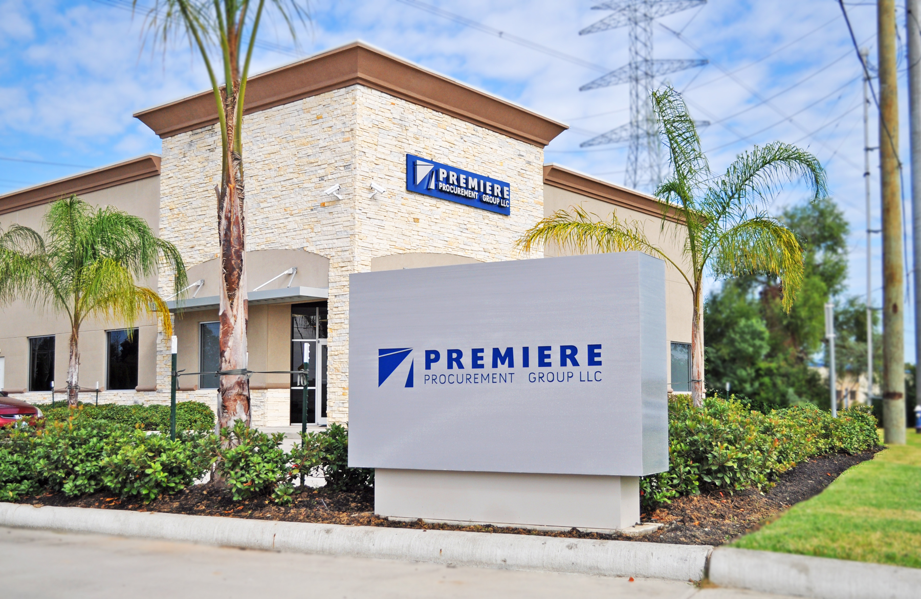 Monument Sign in brushed aluminum for Premier Procurement Group (a division of Tradequip Services). In the background, you can also see a pan sign with brushed aluminum LED lit channel letters